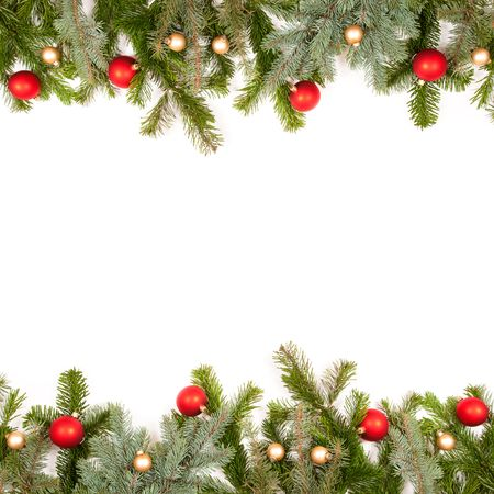 green fir twig frame with christmas balls on white background