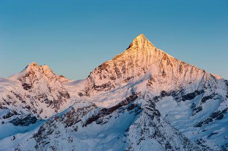 Weisshorn mountain peak at sunrise, view from Gornergrat, Zermatt, Switzerland