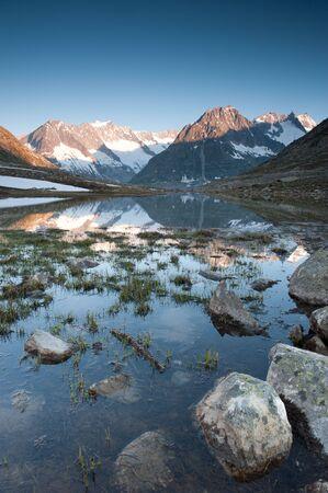 wallis: Maerjelensee in early morning. Part of the Jungfrau-Aletsch UNESCO World Heritage, Wallis, Switzerland.