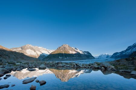 the silence of the world: Maerjelensee in early morning. Part of the Jungfrau-Aletsch UNESCO World Heritage, Wallis, Switzerland.