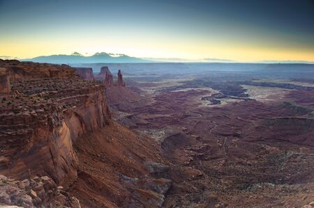 Sunrise at Mesa Arch with Airport Towers in the background, Canyonlands National Park, Utah, USA photo