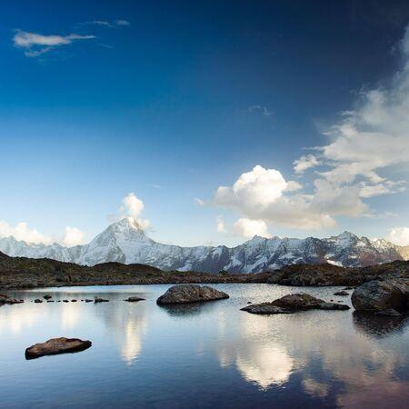 Bietschorn mountain peak reflecting in small lake, Loetschenpass, Wallis, Switzerland