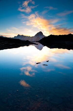 wallis: Bietschorn mountain peak at sunrise reflecting in small lake, Loetschenpass, Wallis, Switzerland