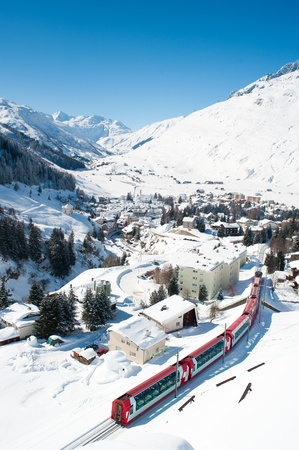 Village Andermatt in winter from above with train passing through, Switzerland