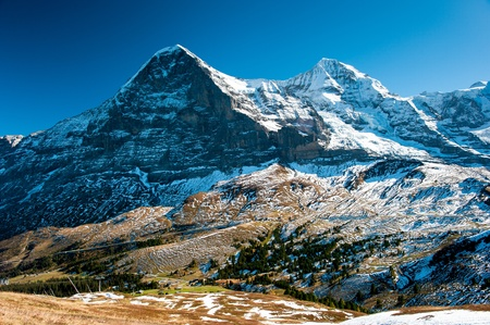 Panorama of Eiger an Monch mountain peaks in autumn, View from kleine Scheidegg, Switzerland