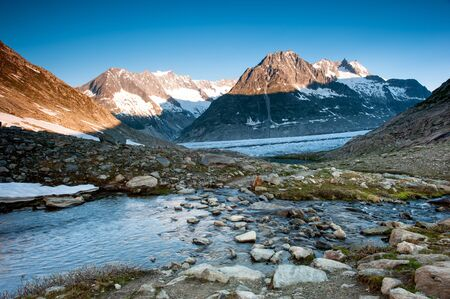 valais: Panorama from Maerjelensee in early morning with Fusshorn and Dreieckshorn. Part of the Jungfrau-Aletsch UNESCO World Heritage, Wallis, Switzerland.