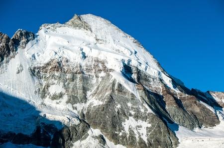 Dent d'Hérens (4171m) mountain peak. View from Schoenbielhuette, Zermatt, Switzerland. Stock Photo - 13160313