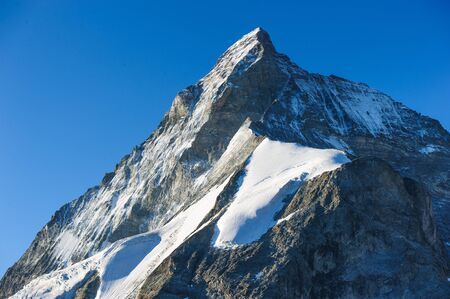 Matterhorn mountain peak, backside, view from Schoenbielhuette, Zermatt, Switzerland photo