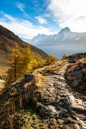 Bietschorn mountain peak in autumn with hiking trail. View from Laucheralp, Loetschental, Wallis, Switzerland
