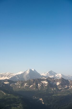 monch: Eiger, Monch and Jungfrau mountain peaks, view from Brienzer Rothorn, Switzerland