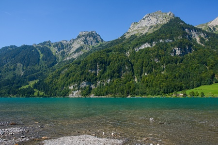 Mountain lake at Kloental, Glarus, Switzerland photo