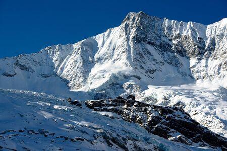Saas Fee: Taeschorn mountain peak with Laengflueh in winter. Saas Fee, Switzerland Stock Photo
