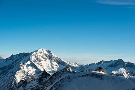 saas fee: Mitelallalin, worlds highest revolving restaurant with Weissmies mountain peak in the background, Saas Fee, Valais, Switzerland