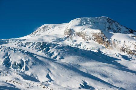 Saas Fee: Albhubel mountain peak in Winter. Saas Fee, Valais, Switzerland