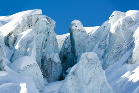 glacial crevasse and ice structures in a glacier above saas fee, valais, switzerland photo