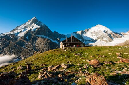 refuge: Panorama with Schoebiel SAC mountain hut and matterhorn, Zermatt, Switzerland. Stock Photo