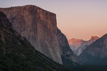 tunnel view: sunset at el capitan and half dome from tunnel view in yosemite nationa park, california, usa