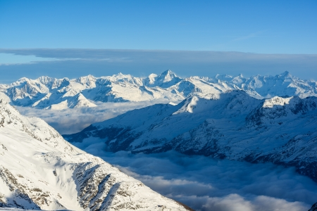 saas fee: Panorama of swiss alps in winter, view from Mitelallalin, Saas Fee, Valais, Switzerland Stock Photo