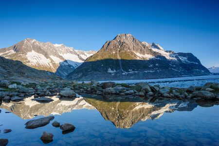 Panorama from Maerjelensee in early morning with Fusshorn and Dreieckshorn. photo