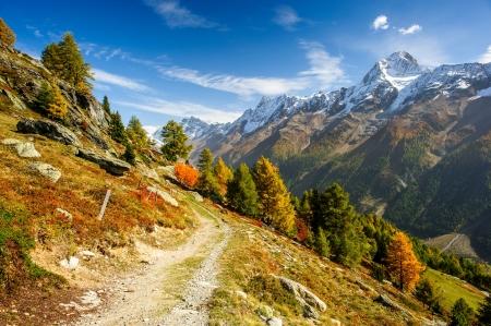switzerland: Bietschorn mountain peak in autumn with hiking trail. View from Laucheralp, Loetschental, Wallis, Switzerland