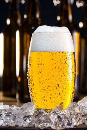 pilsner glass: Beer and ice Stock Photo