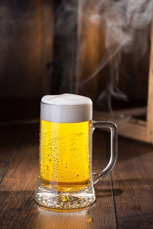 Shiny glass of beer Stock Photo