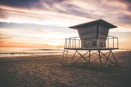 california beach: Lifeguard Tower on the California Beach, United States. Sunset in California.