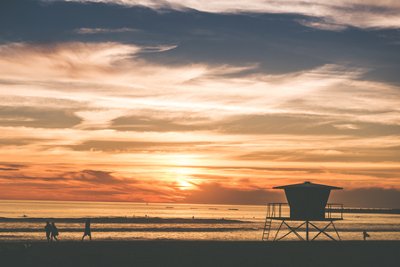 oceanside: Scenic Beach Sunset in Oceanside, California, USA. Beach with Wooden Lifeguard Tower. Stock Photo