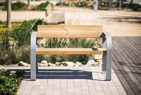 Small Wooden Park Bench in California, USA. Public Park Bench. photo