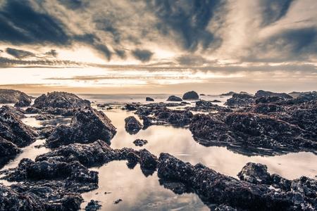 pacific ocean: Rocky Shore Beach Reflections. Pacific Ocean California Shore.