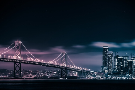 San Francisco Skyline and the Oakland Bay Bridge at Night. California, United States. Reklamní fotografie