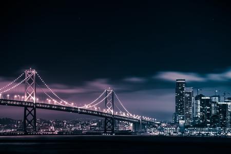 San Francisco Skyline and the Oakland Bay Bridge at Night. California, United States. Archivio Fotografico