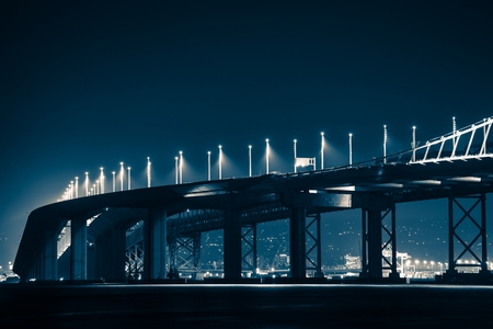 grading: San Francisco Oakland Bay Bridge During Night Hours. Dark Blue Color Grading Stock Photo