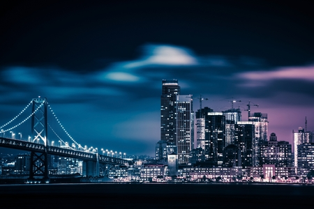bay: San Francisco and the Bay Bridge at Night. San Francisco Skyline.