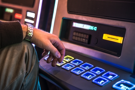 Frustrated Men Playing Slot Machine. Gambling Problem Concept.