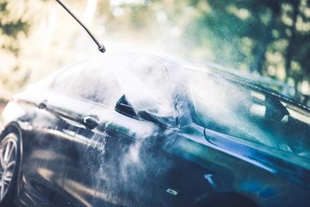 Self Car Washing on a Backyard. High Pressure Washer.