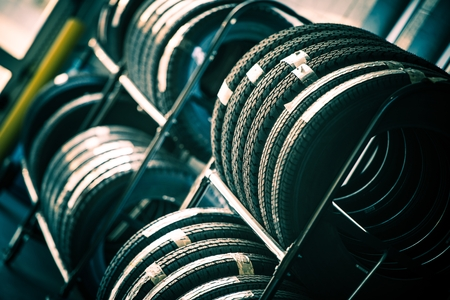 auto service: Tires Rack. Brand New Car Tires For Sale. Stock Photo