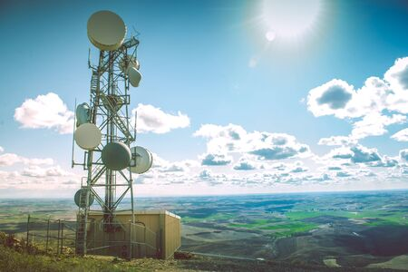 tower: Small Cellular Tower on a Hill. Cellular Technology.