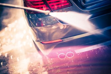 Car Cleaning Closeup. Cleaning Using Pressure Machine