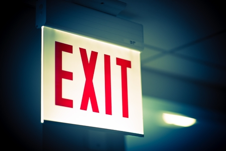 fire exit sign: Illuminated Corporate Office Exit Sign Closeup. Stock Photo
