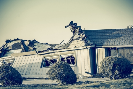 aftermath: The Aftermath of a Tornado. Completely Destroyed Building. Closeup Photo.