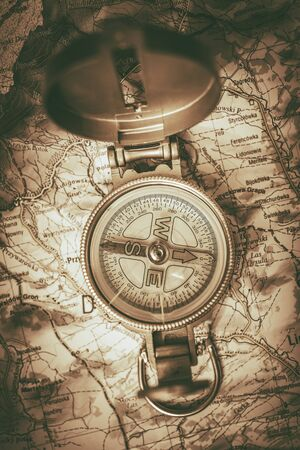 compass rose: Outdoor Adventure Concept with Cool Old Compass and the Map. Sepia Color Grading.