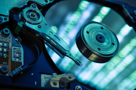 Data Recovery Concept. Secure Data Hard Drive Storage Recovery. Open Computer Hard Drive Closeup.