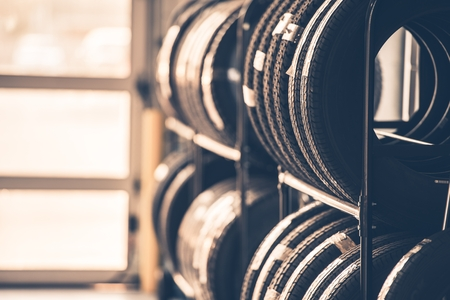 rack wheel: Car Tires Rack. Brand New Tires for Compact Vehicles on the Metal Display.