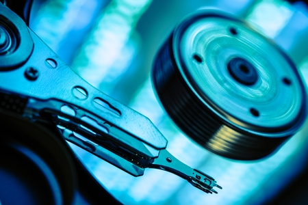 rewriting: Computer Data Safe Storage Concept Photography. Modern Computer Hard Drive Closeup.