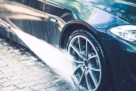 Car Alloy Wheels Washing by High Pressure Portable Washer.