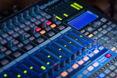 switcher: Concert Audio Mixer Closeup Photo. Audio Technology.
