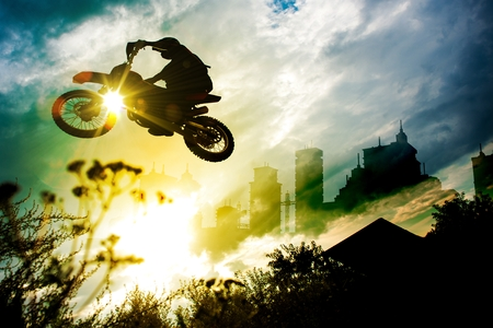 dirt bike: Urban Dirt Bike Jump. Motocross Concept Illustration with Abstract Background with the City Skyline.