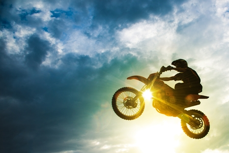 motors: Motocross Bike Jump. Motocross Sport Action Photo.