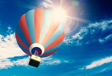 ballooning: Hot Air Balloon on the Blue Cloudy Sky. 3D Illustration. Stock Photo
